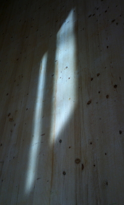 Light from window on wooden wall